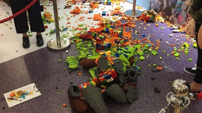 kid destroy LEGO sculpture